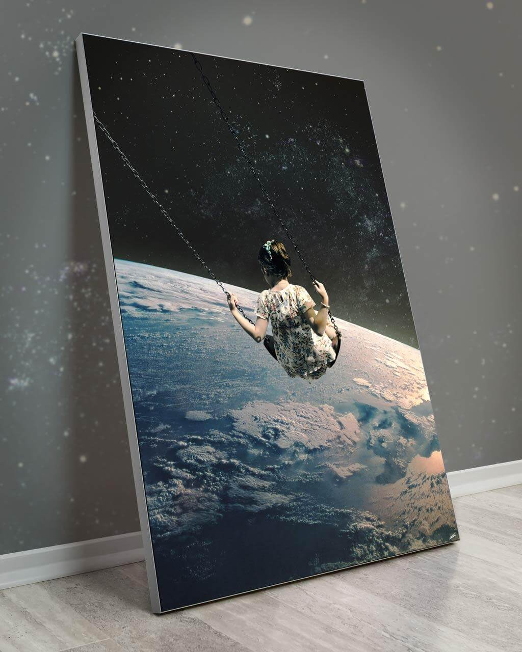Oversized galaxy wall decor with a little girl swinging in outer space about earth